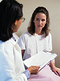 Photo of two women in medical consult.